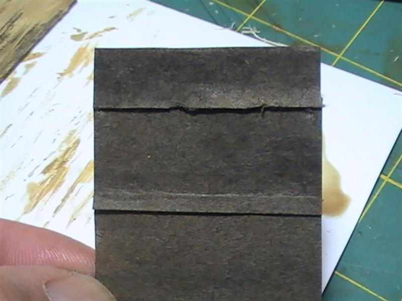If You Want Really Aged Tar Paper, Then Take A Brush With Just Plain Water  And Soak Some Spots Of The Roof.